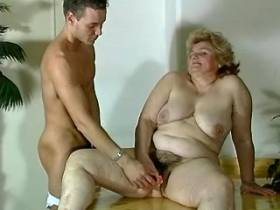 Fat mommy gives blowjob to hot dude