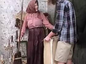 Lewd granny in headscarf blows cock with pleasure