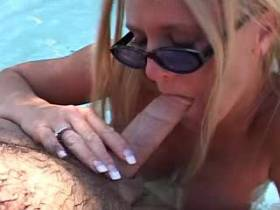 Blonde milf has satisfy in different poses in pool