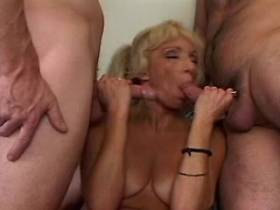 Blonde lewd mature sucks cocks and fucks in gangbang