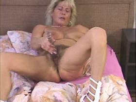 Blackie cums on hairy pussy of busty blonde mature