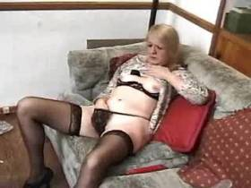 Aged mature plays with dildo and sucks thick cock