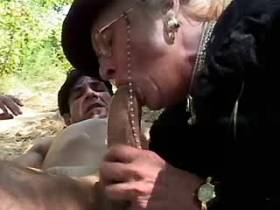 Granny fucks from behind and gets facial outdoor