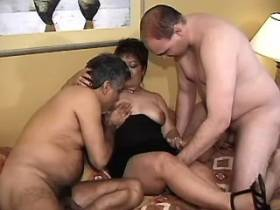 Chubby brunette mature getting three cocks in orgy